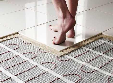 Электрический теплый пол под плитку какой лучше - инфракрасный или кабельный